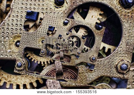 Collage of Bronze Clock Mechanism with cogwheels taken closeup.Digitally altered image.