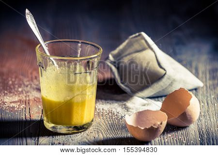 Closeup Of Eggs Yolks And Sugar In Glass