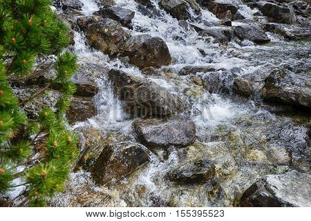 view of water stream on slopes of mountains