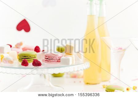 Table with sweets and lemonade ready for celebration over white background