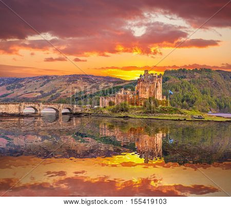 Eilean Donan Castle Against Sunset In Highlands Of Scotland