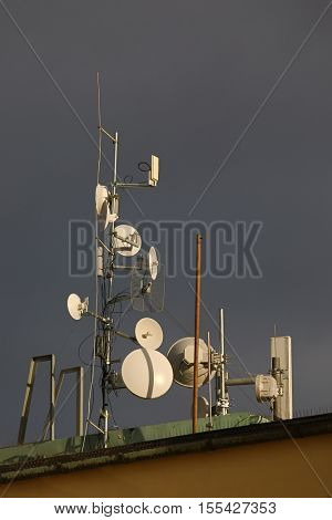 Communication transmitters on an urban roof