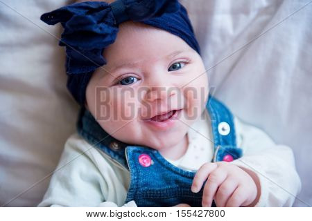 baby girl laughing with a head bow