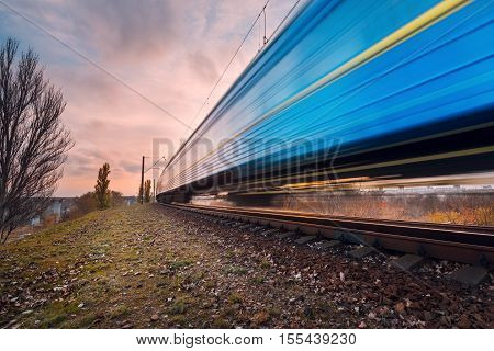High Speed Blue Passenger Train On Railroad Track In Motion