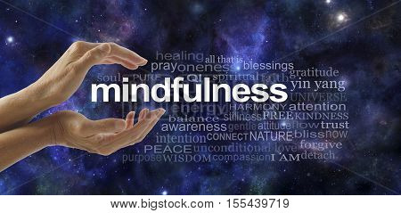 Mindfulness Meditation Word Cloud - side view of female cupped hands with the word MINDFULNESS between surrounded by a relevant word cloud on a dark blue deep space background