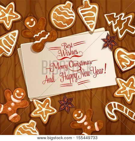 Christmas gingerbread man, xmas tree and ball, candy cane, star, heart cookie and anise placed around greeting card with wishes of Merry Christmas. Wooden background with ginger cookie for xmas design
