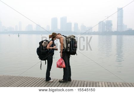 The loving couple on coast of lake in downtown