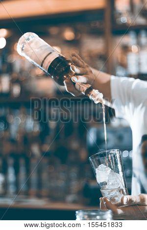 Bartender Prepares A Cocktail In The Nightclub.