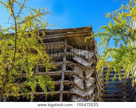 demolition of building in fall with yellow leaves