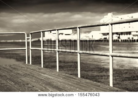 Quay border fence in sepia background hd