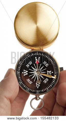 Compass in a hand isolated on white