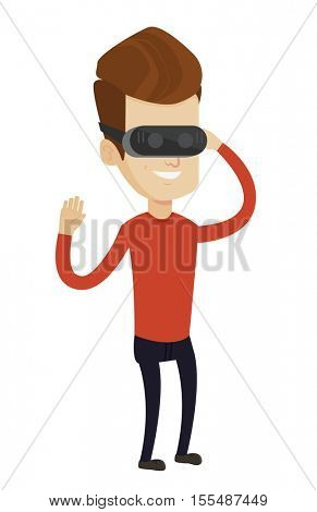 Young cheerful caucasian gamer wearing virtual reality headset. Happy gamer using virtual reality glasses and playing virtual video game. Vector flat design illustration isolated on white background.