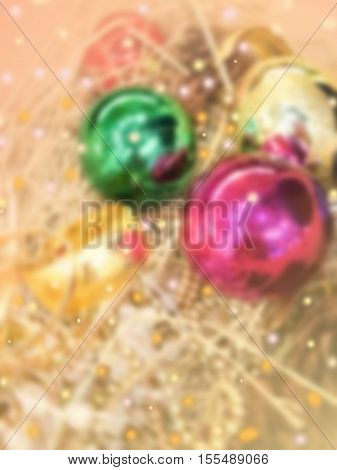 de-focused beautiful Christmas ornaments with shiny colorful light