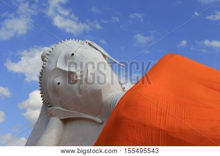 Reclining of buddha in temple Angthong Thailand on sky background
