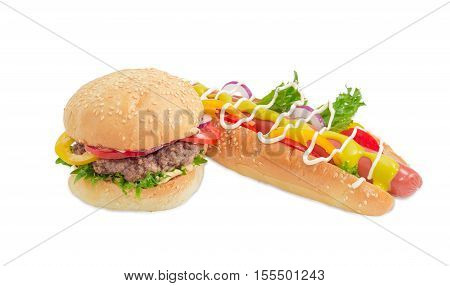 Hamburger with beef patty vegetables and condiments and hot dog with frankfurter mustard mayonnaise and vegetables on a light background