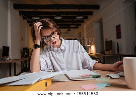 Beauty office woman. thoughtful. sits by the table