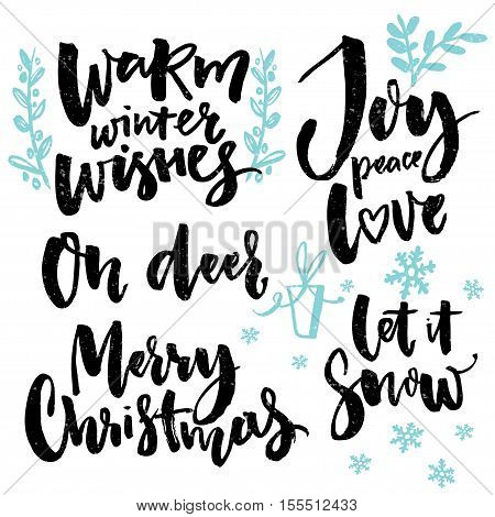 Merry Christmas type and seasonal greetings. Handwritten words for greeting cards posters and gift tags. Christmas wishes set: warm winter wishes, joy, peace and love, oh deer.