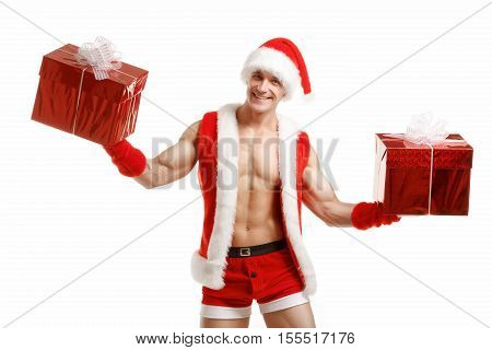 Sexy fitness Santa holding a red boxes. Muscular Santa Claus holding Christmas present in red box. Fitness Santa Happy New Year. Bodybuilder Santa with red box on a white background. Santa Claus isolated
