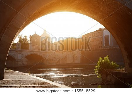 Rome Italy - scenic view of river Tiber at sunset on background St. Peter's Basilica dome