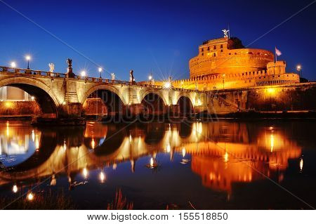 Castel Sant'Angelo and bridge over river Tiber at night Rome Italy