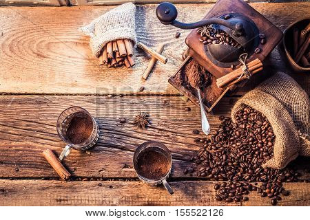 Smell of freshly grinded coffee on old wooden table