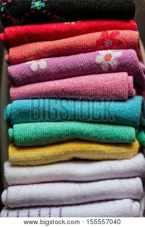 A pile of colorful clothes. A pile of colorful clothes