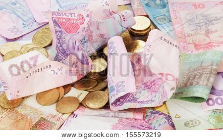 Ukrainian money of various face value and a penny. Background. Finance concept.