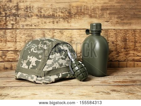 Set of military outfit on wooden background, close up