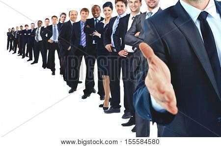Business group in a row. leader with open hand and ready to shake your hand