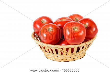 Fresh red tomatoes in basket isolated on white. Selective focus