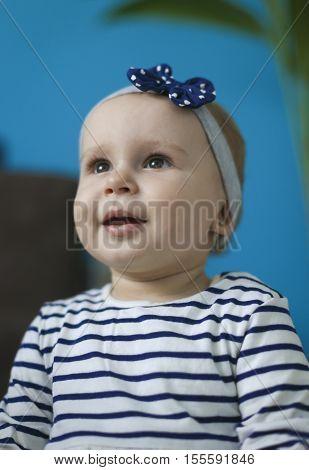 Portrait of adorable baby girl with headband
