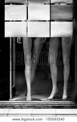Mannequin legs in a showcase. Place for signature.