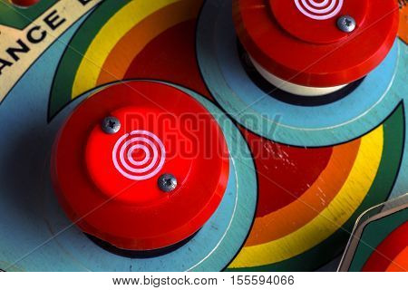 Red bumpers on a retro pinball machine