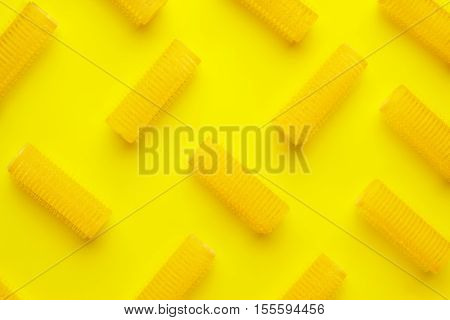 hair curlers on the yellow paper background
