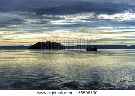 Sunrise in Mageroya island, Norway. Mageroya is a large island in Finnmark county, in the extreme northern part of Norway. The island lies along the Barents Sea in Nordkapp Municipality