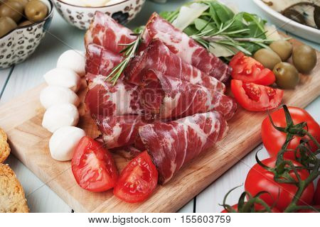 Slices of italian capicola or capocollo, cured and aged pork meat