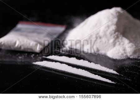 Two Lines And Pile Of Cocaine On Black Background