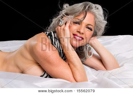 Woman In A Bed Smiling