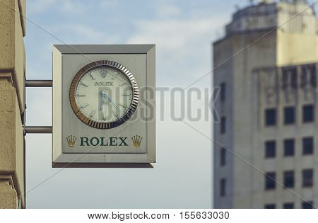 Bucharest Romania - May 13 2014: Rolex brand store signage in central Bucharest. Founded in 1905 Rolex is the largest luxury watch brand producing about 2000 watches per day.