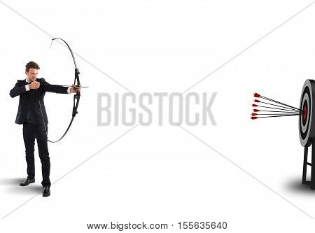 Businessman with bow and arrows hits target