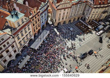 PRAUGE, CZECH REPUBLIC - APRIL 26, 2012: Tourist crowd watching Prague astronomical clock animated figures hourly motion on the Old Town Square