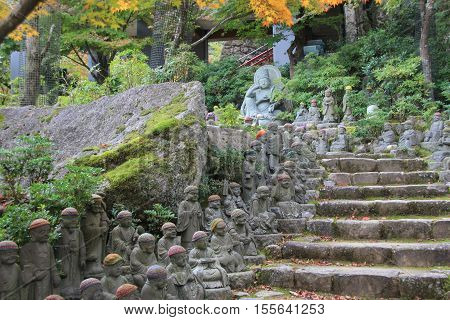 Stairs lined with small Buddhist in Daishō-in, Itsukushima, Japan