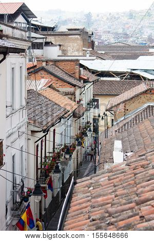 looking down at the rooftops and lower streets in Old Quito Ecuador
