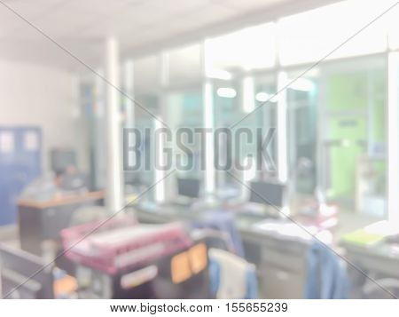 Blurred image of counter service at hotel for background usage.Blur abstract background hall customer or cashier desk indoor space in office bank interior:staff working.lab