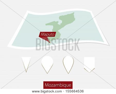 Curved Paper Map Of Mozambique With Capital Maputo On Gray Background. Four Different Map Pin Set.