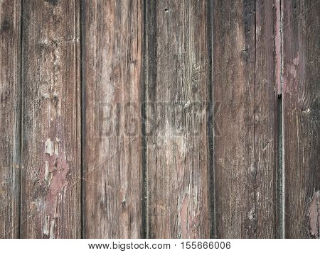 Picture of the old wooden fence closeup. Background of the wooden texture. Wooden pattern on the old fence. An old planking of the fence.