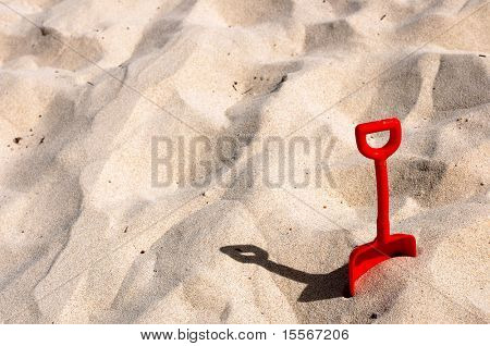 Children red blade in the sand on the beach