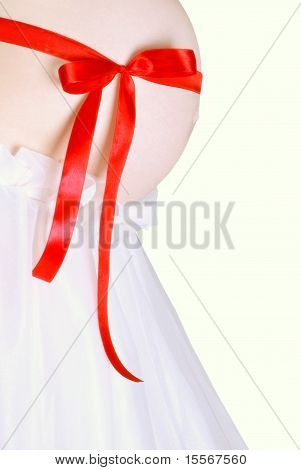 Pregnant belly with red ribbon