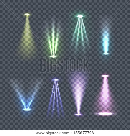 Set of spotlights rays. Vector illustration on transparent background. Yellow, green, blue, violet glowing upper and lower lights. Concert lighting, party, nightclub, advertising and city lights