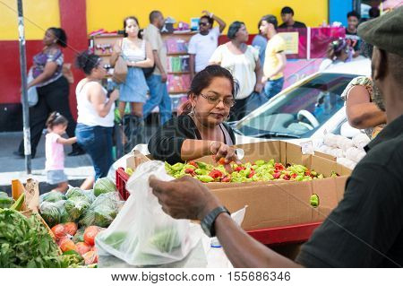 Old Woman Buys Vegetables